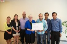 NGO presents PWRDF with cheque for earthquake relief