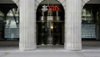 Switzerland submits to U.S. pressure, relaxes bank secrecy