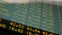 TSX dips on stimulus fears, sluggish data