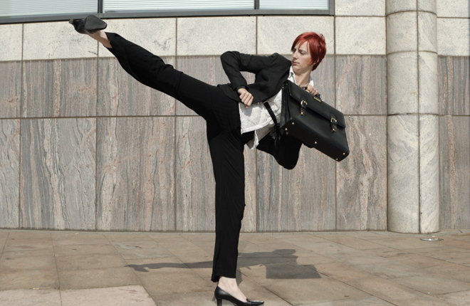Businesswoman martial arts kick