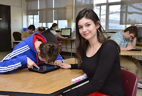 Girl sitting at a table with a male student