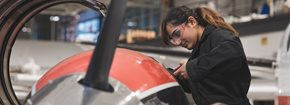 Female student working on an aircraft