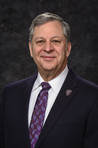 John P. Smith, Jr. DO (COM '75), FACOS