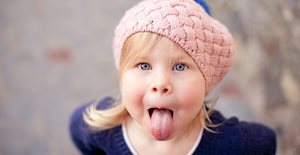 kid sticking out her tongue