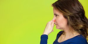 woman, plug nose