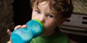 child, boy, sippy bottle