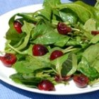 Spinach and Bitter Green Salad Recipe with Fresh Raspberry-Aloe Vinaigrette
