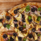 Grain-free Cauliflower Pizza Crust Recipe Topped with Black Olives and Artichokes