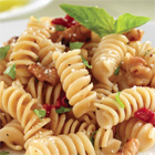Barilla PLUS® Rotini with Walnuts, Sun-Dried Tomatoes, Parmigiano Reggiano Cheese, and Basil