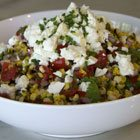 Charred corn salad with tomatoes and feta