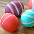 Dyed Easter eggs with rubber band stripes