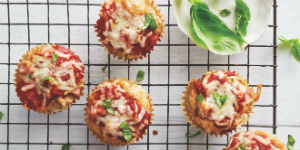 mini pizza muffins on a cooling rack