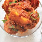 Curried potatoes with tomatoes and fenugreek