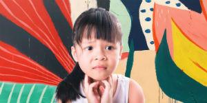 little girl holding her sore throat