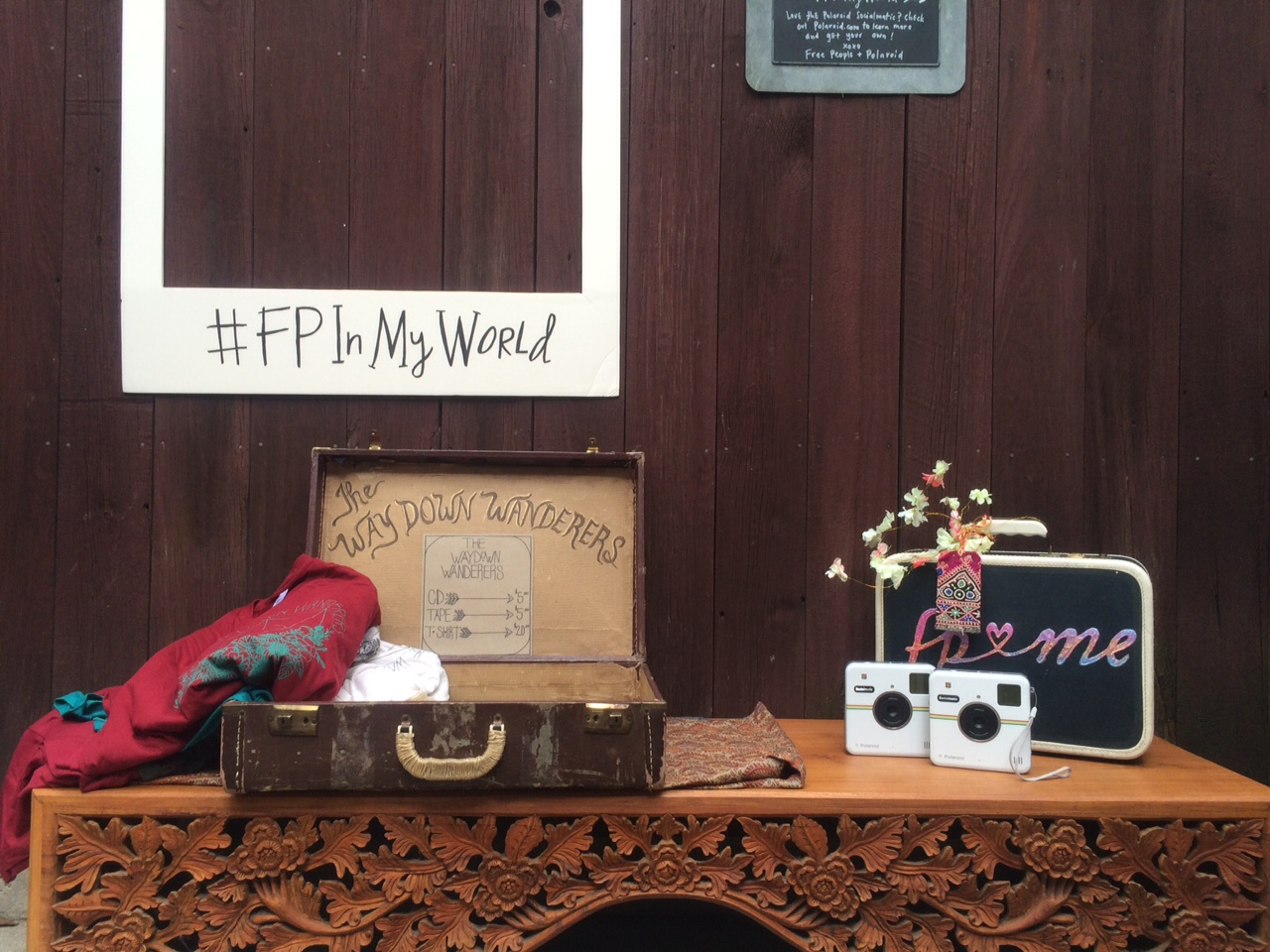 fp <3 me suitcase and Polaroid cameras on a table
