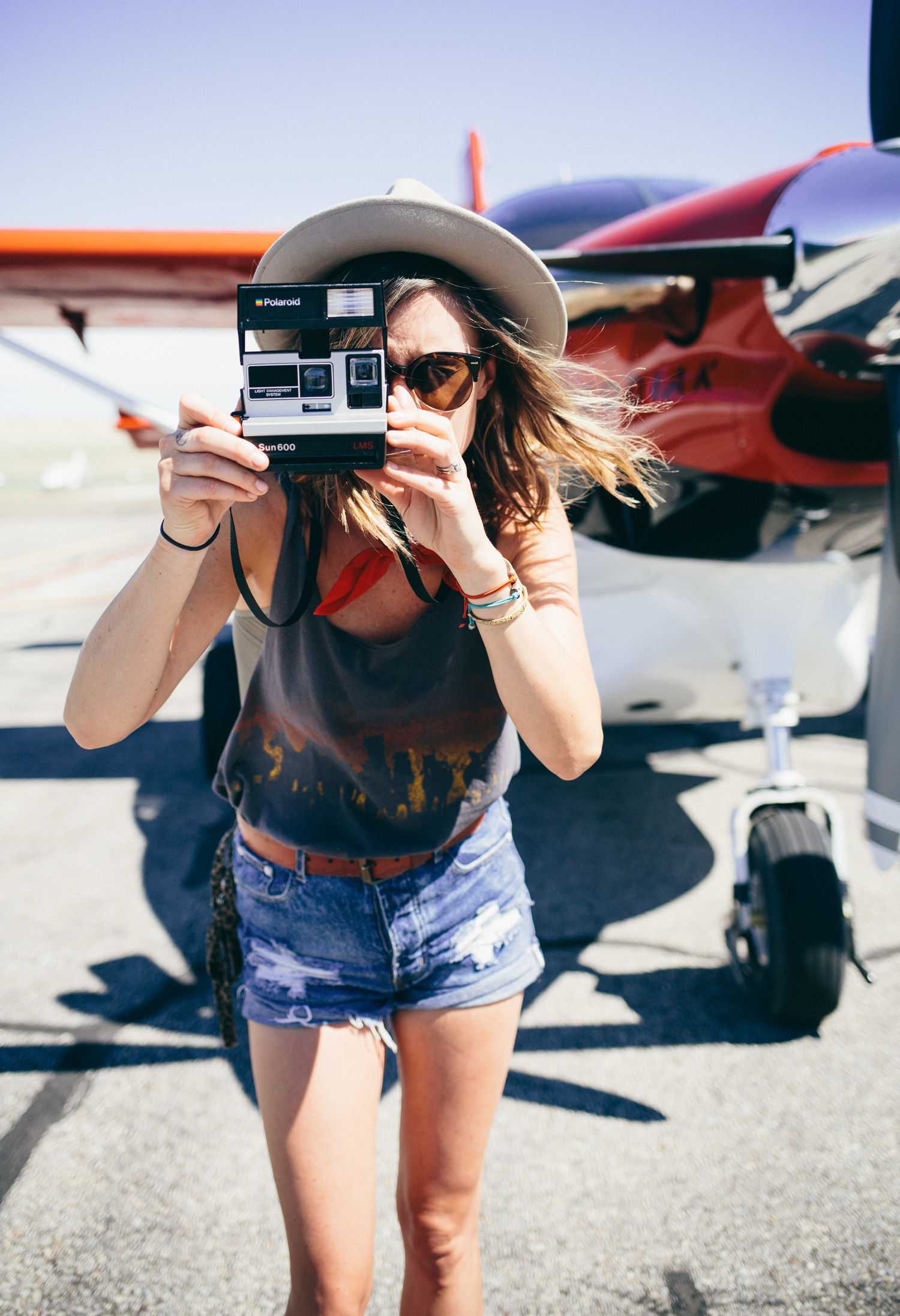 photo of girl taking a photo with a Polaroid camera