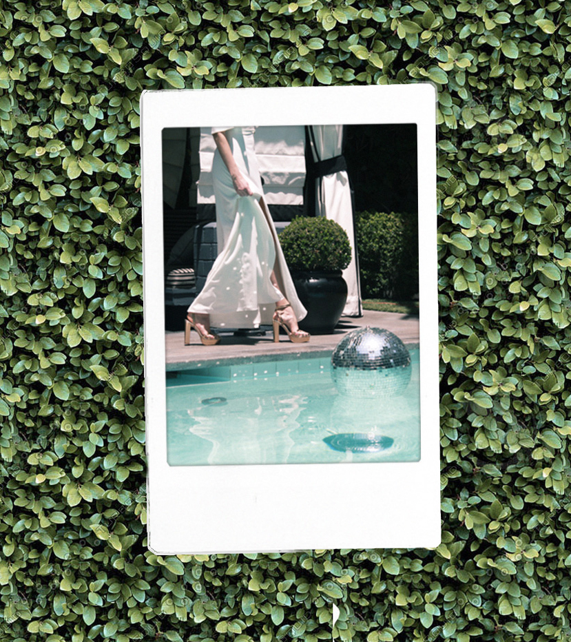 Polaroid of a disco ball floating in a pool