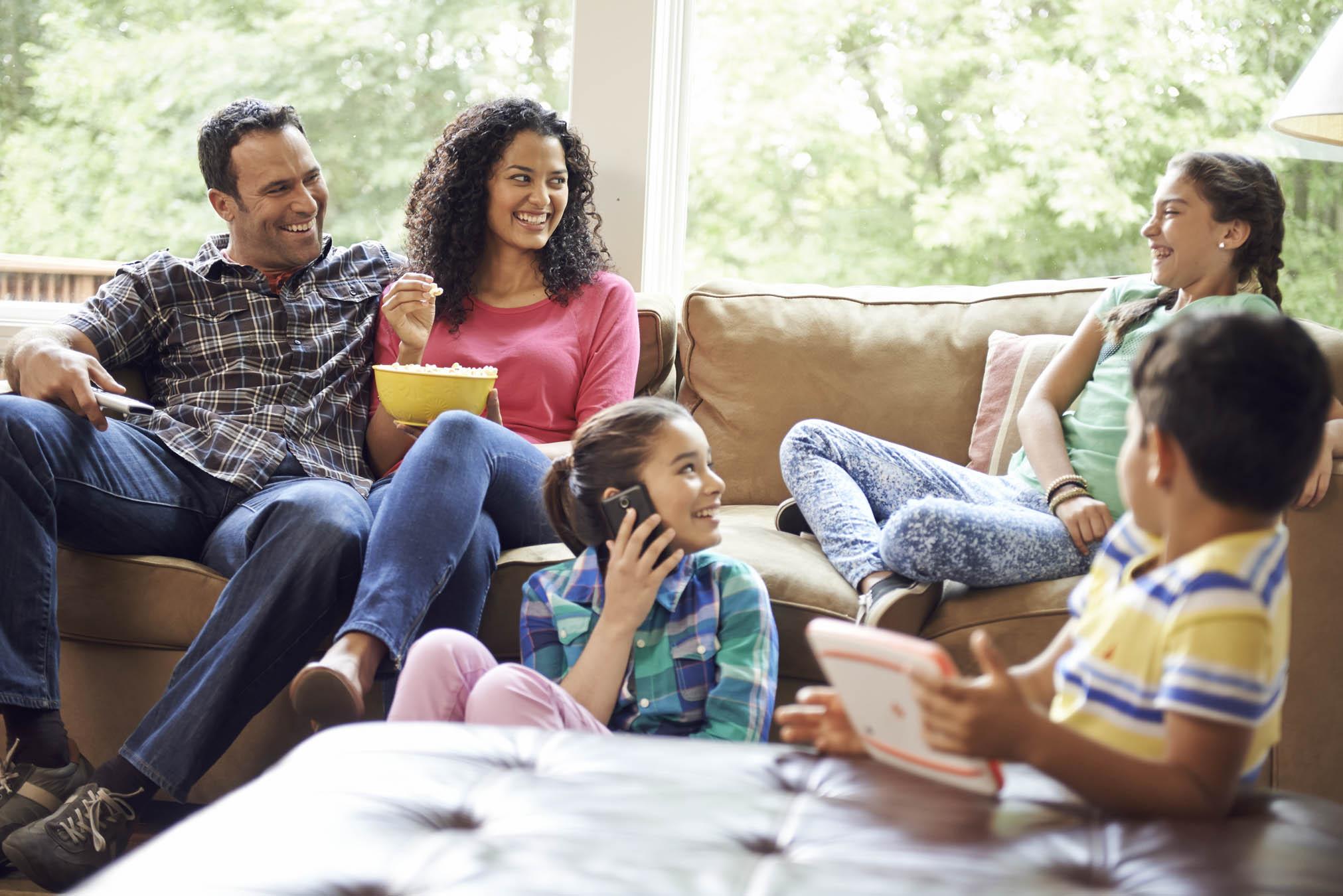 Family enjoying Polaroid 4K UHD LED TV with Google Cast