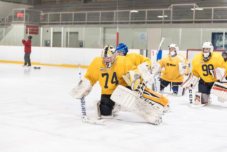 Photo of young hockey players performing drills at the Source For Sports Goalie Demo Day.