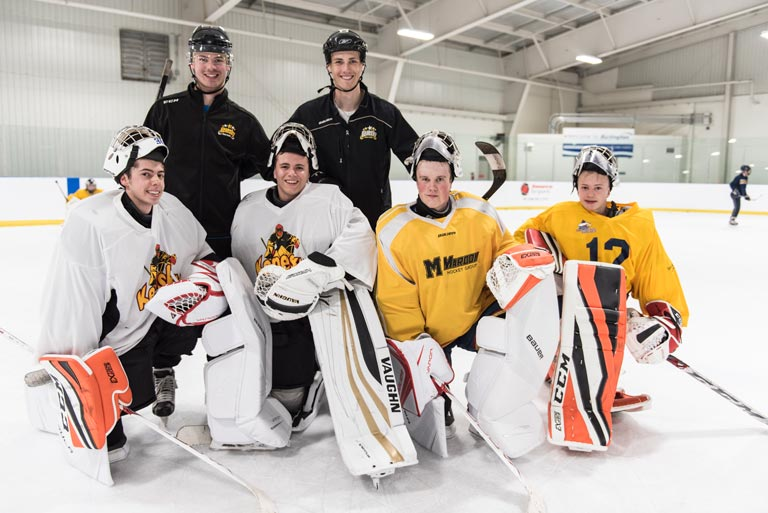 Picture of young hockey goalies smiling and having fun at the Source For Sports Goalie Demo Day