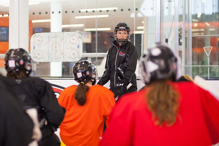 Megan Kobar now coaches girls hockey players in Calgary, Alberta while working for her father's store Adrenalin Source For Sports.