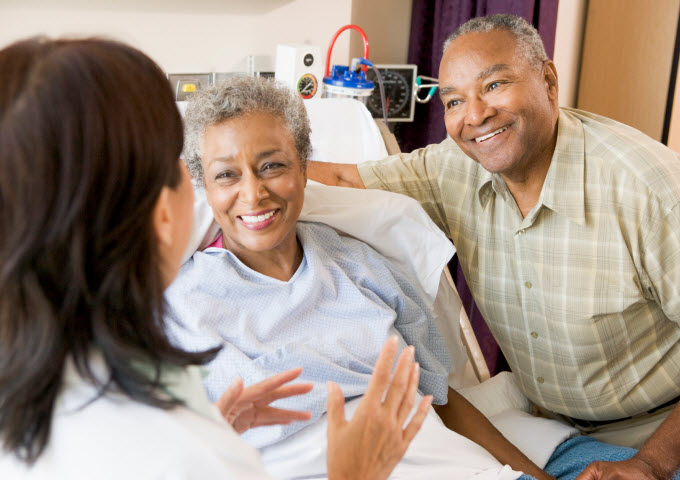 Healthcare automation - couple talking to nurse