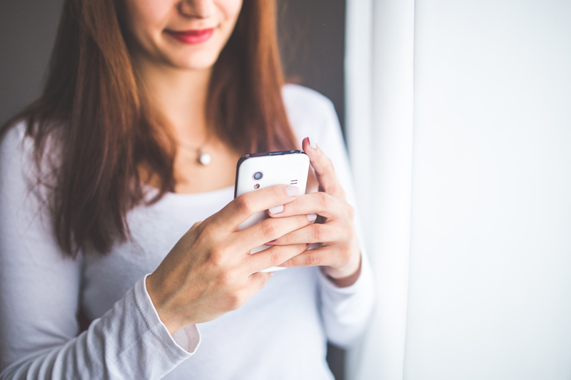 woman holding a cell phone