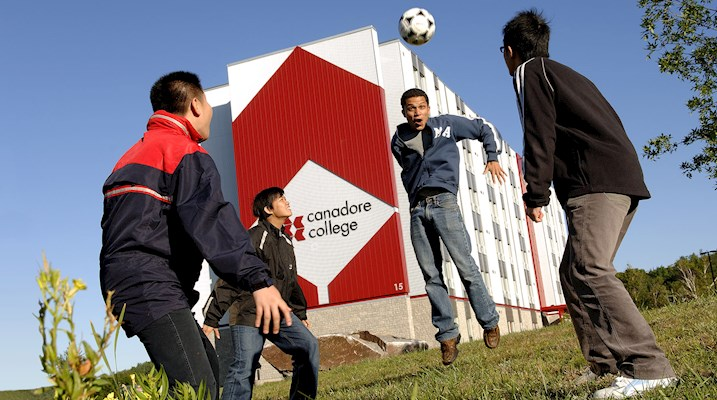 Students playing soccer outside of residence