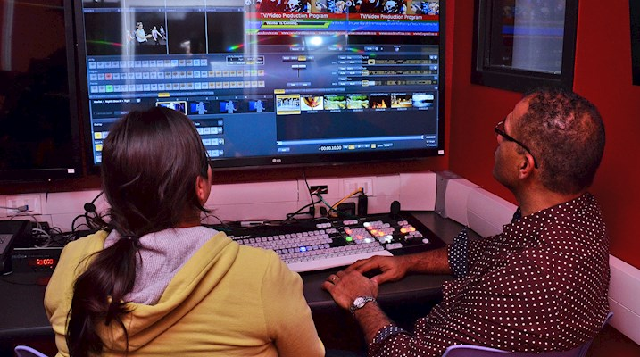 Student and teacher working in an editing suite