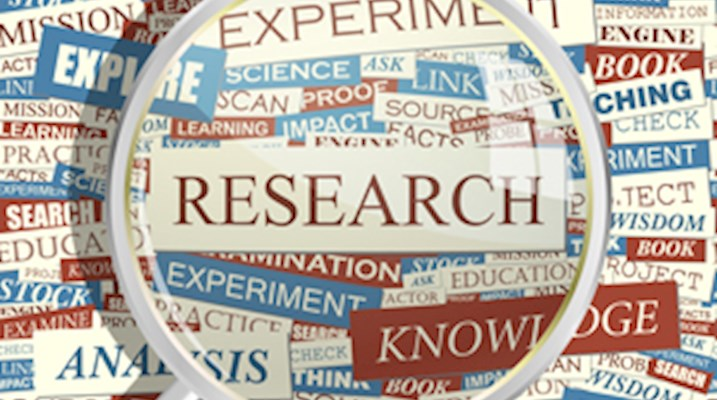 magnifying glass with the work research