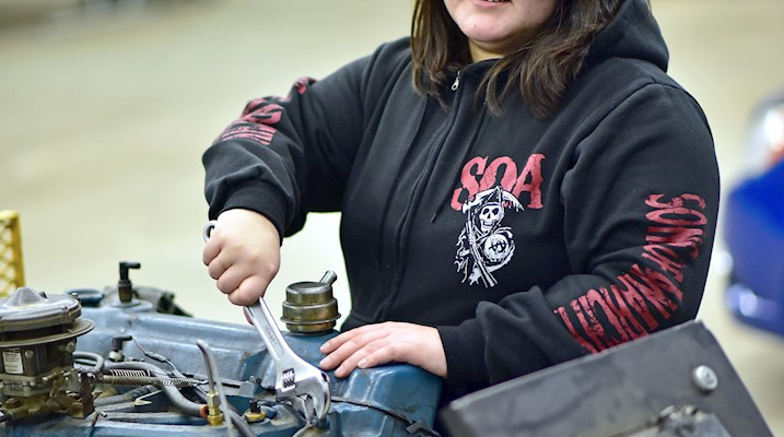Indigenous woman working on an engine