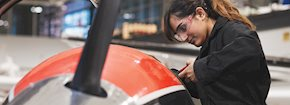 female student working on a plane