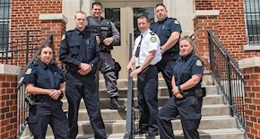 Corrections officers outside of a jail