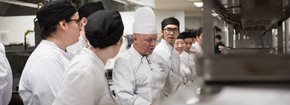 Group of students listening to a chef