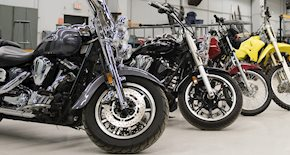 Motorcycles lined up in a row.