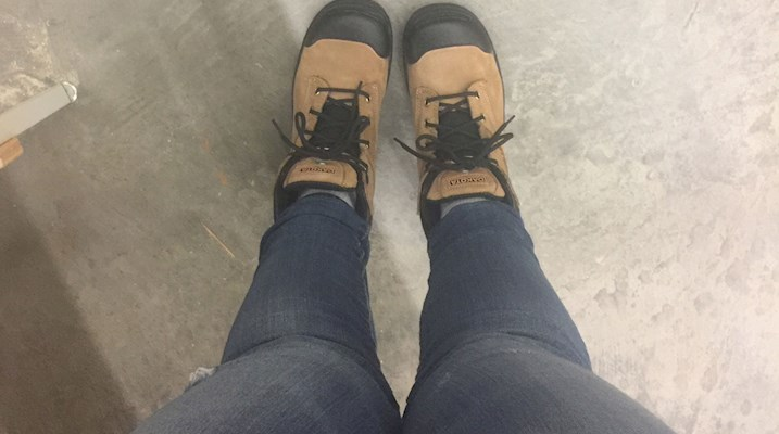 Feet wearing workboots