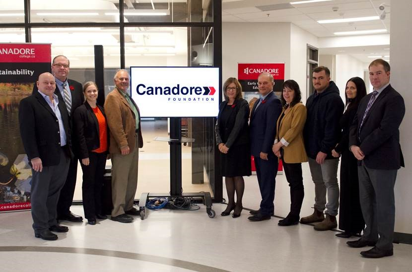 President George Burton joins Canadore College Foundation Board in a group photo with the New Canadore Foundation brand.