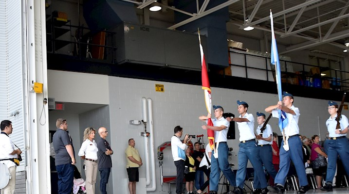 Group of cadets marching out of an airplane hangar
