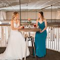 A bride having drinks on the upper floor of The Amsler Building.
