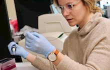 KCU's second-year College of Biosciences student Amy Wysong working in a lab.