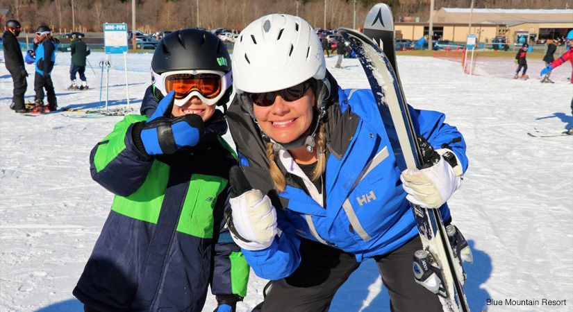 Instructor with boy at ski school at Blue Mountain Ski Resort