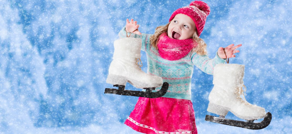 Girl with ice skates smiling