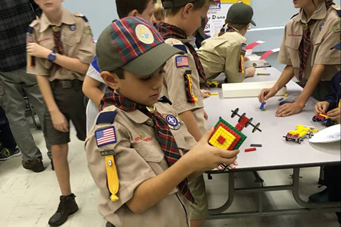Boys Scouts building with Legos