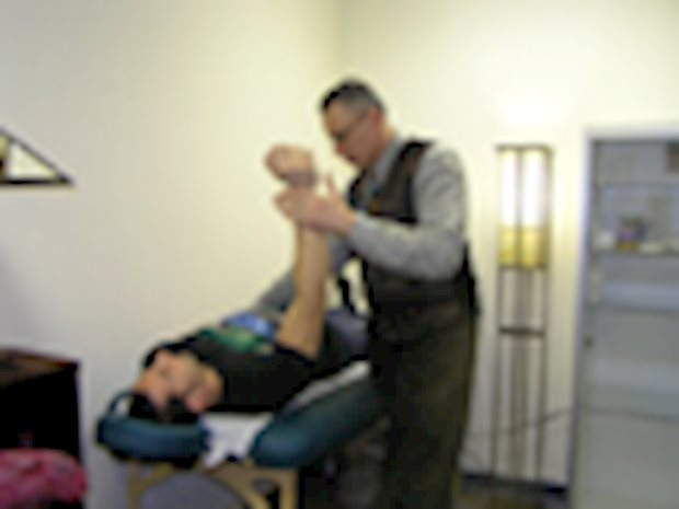 Dr. Vincent D'Amico working with a patient