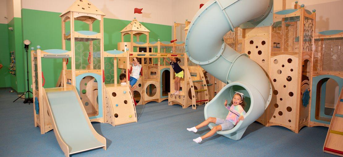 Children having fun on our indoor playset - Exceptional Explorers