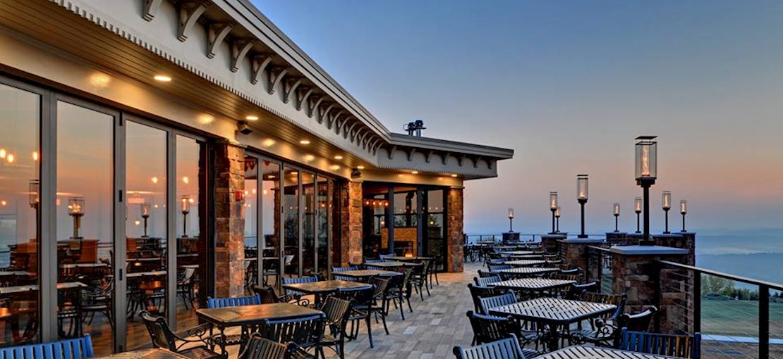 Enjoy a delicious meal after a day of adventure with a spectacular view at Slopeside Pub & Grill