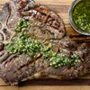 steak topped with an herbed marinade