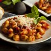 plate of gnocchi with tomato sauce and cheese