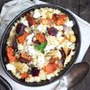 bowl of couscous with roasted veggies and goat cheese crumbles