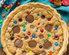 giant cookie pie studded with m and m candies and peanut butter cups